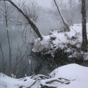Spring river blanketed in snow